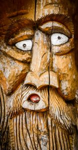 Face Carved Into Wood